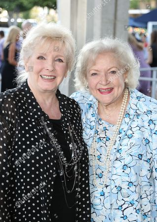 """Actresses Millicent Martin, left, and Betty White, right, pose during the arrivals for the opening night performance of """"Red"""" at the Center Theatre Group/Mark Taper Forum, in Los Angeles, Calif"""