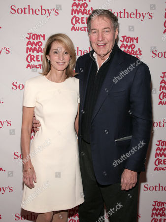Television journalist Charlie Rose, right, and his wife Mary King, left, attend Jony & Marc's (Red) Auction at Sotheby's New York to benefit The Global Fund to fight AIDS on Saturday Nov., 23, 2013 in New York