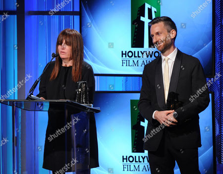 """From left, production designer Judy Becker and costume designer Michael Wilkinson accept the """"Hollywood Costume and Production Design Award"""" onstage during the 17th Annual Hollywood Film Awards Gala at the Beverly Hilton Hotel on in Beverly Hills, Calif"""