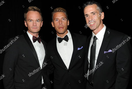 SEPTEMBER 15: (L-R) Neil Patrick Harris, Terry Miller and Dan Savage backstage at the Academy of Television Arts & Sciences 64th Primetime Creative Arts Emmy Awards at Nokia Theatre L.A. Live on in Los Angeles, California