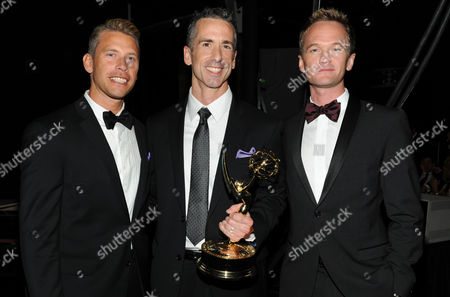 SEPTEMBER 15: (L-R) Terry Miller, Neil Patrick Harris and Dan Savage backstage at the Academy of Television Arts & Sciences 64th Primetime Creative Arts Emmy Awards at Nokia Theatre L.A. Live on in Los Angeles, California