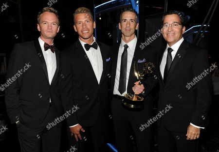 SEPTEMBER 15: (L-R) Neil Patrick Harris, Terry Miller, Dan Savage and Academy Cjairman & CEO Bruce Rosenblum backstage at the Academy of Television Arts & Sciences 64th Primetime Creative Arts Emmy Awards at Nokia Theatre L.A. Live on in Los Angeles, California