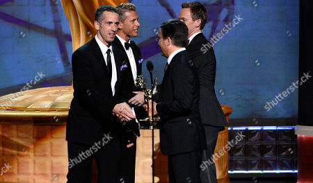 "SEPTEMBER 15: (L-R) Dan Savage and Terry Miller accept the Governors Award for ""It Gets Better Project"" from presenters Academy Chairman & CEO Bruce Rosenblum and actor Neil Patrick Harris onstage at the Academy of Television Arts & Sciences 64th Primetime Creative Arts Emmy Awards at Nokia Theatre L.A. Live on in Los Angeles, California"