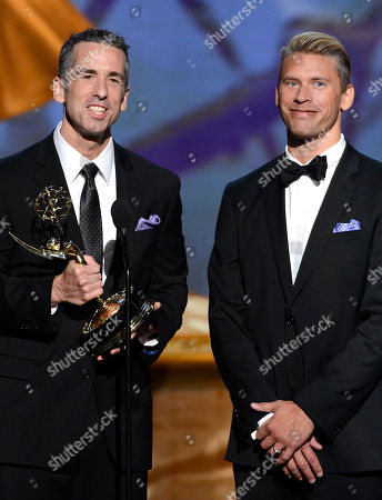 "SEPTEMBER 15: (L-R) Dan Savage and Terry Miller accept the Governors Award for ""It Gets Better Project"" onstage at the Academy of Television Arts & Sciences 64th Primetime Creative Arts Emmy Awards at Nokia Theatre L.A. Live on in Los Angeles, California"
