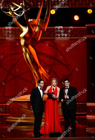 SEPTEMBER 15: (L-R) Presenters Eddy Kitsis, Jennifer Morrison, and Adam Horowitz present the Outstanding Costumes For A Series award at the Academy of Television Arts & Sciences 64th Primetime Creative Arts Emmy Awards at Nokia Theatre L.A. Live on in Los Angeles, California