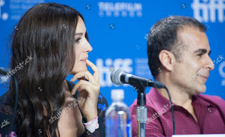 "Actress Monica Bellucci and director/writer/producer Bahman Ghobadi participate in a photo call and press conference for the film ""Rhino Season"" at TIFF Bell Lightbox during the Toronto International Film Festival, in Toronto"