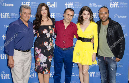 "Actor Behrouz Vossoughi, actress Monica Bellucci, director/writer/producer Bahman Ghobadi, actress Belçim Bilgin and actor Arash Labaf participate in a photo call and press conference for the film ""Rhino Season"" at TIFF Bell Lightbox during the Toronto International Film Festival, in Toronto"
