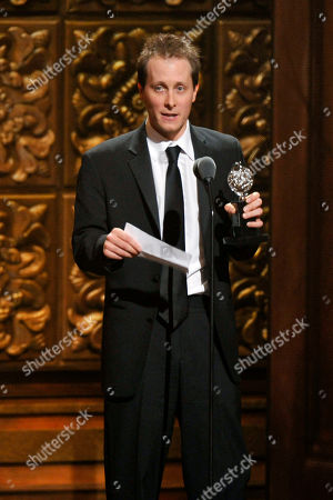 """Stock Image of Jeff Croiter accepts the best lighting design of a play award for his work on """"Peter and the Starcatcher"""" at the 66th Annual Tony Awards, in New York"""