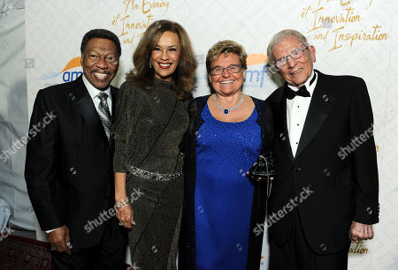 From left, Billy Davis, Jr., Marilyn McCoo, Claudia Mann and Alfred Mann arrive at the 10th annual Alfred Mann Foundation Gala, in Beverly Hills, Calif