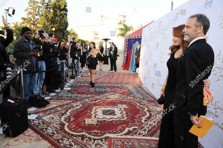 Amy Yasbeck, left, and Michael Plonsker arrive at the 10th annual Alfred Mann Foundation Gala, in Beverly Hills, Calif