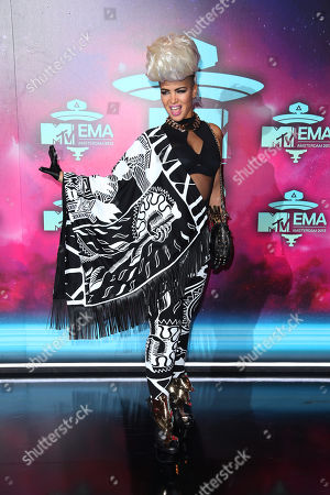Eva Simons poses for photographers upon arrival at the 2013 MTV Europe Music Awards, in Amsterdam, Netherlands