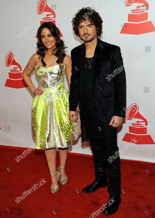 Karla Monroig, left, and Tommy Torres arrive at the Latin Recording Academy Person of the Year tribute, in Las Vegas