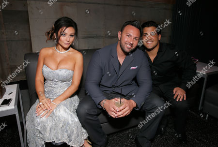 """Stock Image of From left, Jenni """"Jwoww"""" Farley, Roger Matthews and Jionni Lavalle attend the MTV Movie Awards in Sony Pictures Studio Lot in Culver City, Calif., on"""