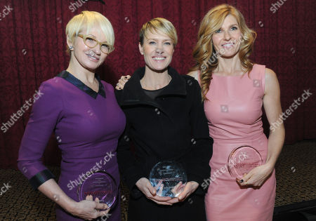 IMAGE DISTRIBUTED FOR NEW YORK WOMEN IN FILM AND TELEVISION - Ellen Barkin, Robin Wright and Connie Britton, left to right, pose together after the 2013 Muse Awards, presented by New York Women in Film & Television, in New York. The event also honored Sonia Manzano, actress and writer on Sesame Street, and Frances Berwick, President of Bravo and Oxygen Media