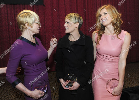 IMAGE DISTRIBUTED FOR NEW YORK WOMEN IN FILM AND TELEVISION - Ellen Barkin, Robin Wright and Connie Britton, left to right, chat together after the 2013 Muse Awards, presented by New York Women in Film & Television, in New York. The event also honored Sonia Manzano, actress and writer on Sesame Street, and Frances Berwick, President of Bravo and Oxygen Media
