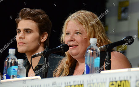 "Paul Wesley, left, and producer Julie Plec attend the ""Vampire Diaries"" panel on day 3 of Comic-Con International, in San Diego"