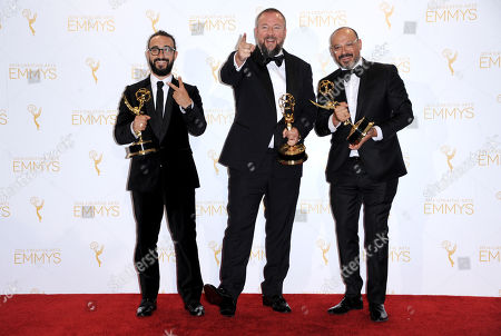 From left, BJ Levin, Shane Smith, and Eddy Moretti pose in the press room with the award for outstanding informational series or special for Anthony Bourdain: Parts Unknown at the 2014 Creative Arts Emmys at Nokia Theatre L.A. LIVE, in Los Angeles