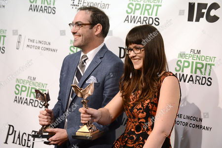 "Chad Hartigan, left, and Cherie Saulter pose in the press room with the John Cassavetes award for ""This is Martin Bonner"" at the 2014 Film Independent Spirit Awards,, in Santa Monica, Calif"
