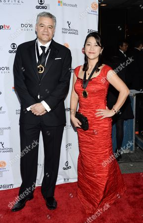 Stock Picture of Damon Vignale, left, and Miho Yamamoto attend the International Emmy Awards gala at the New York Hilton, in New York