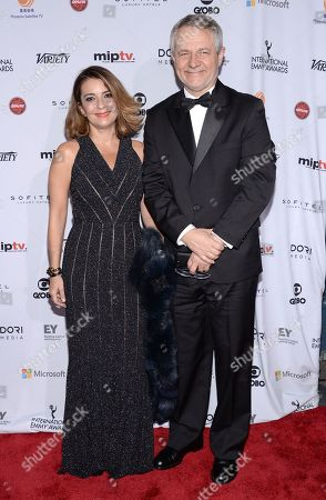 Stock Photo of Carlos Henrique Schroder, right, attends the International Emmy Awards gala at the New York Hilton, in New York