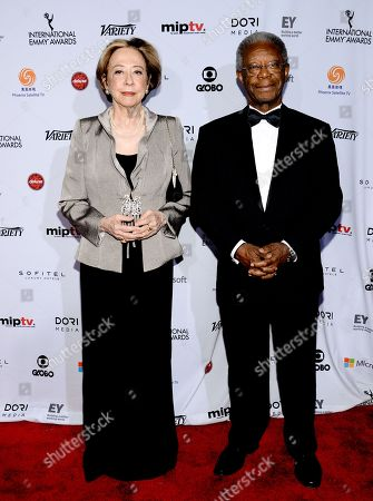 Stock Photo of Fernanda Montenegro and Milton Goncalves attend the International Emmy Awards gala at the New York Hilton, in New York