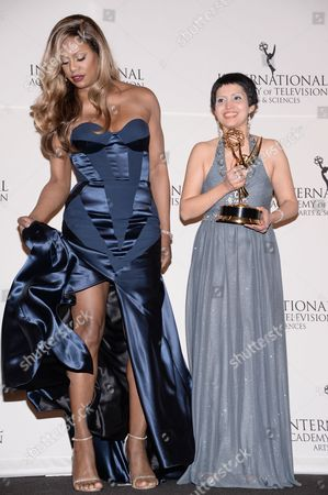 "Documentary"" award winner Maryam Ebrahimi poses with presenter Laverne Cox in the International Emmy Awards press room at the New York Hilton, in New York"