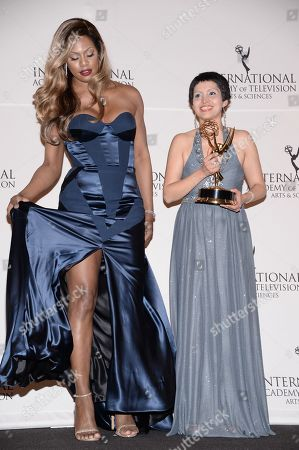 """Stock Image of Documentary"""" award winner Maryam Ebrahimi poses with presenter Laverne Cox in the International Emmy Awards press room at the New York Hilton, in New York"""