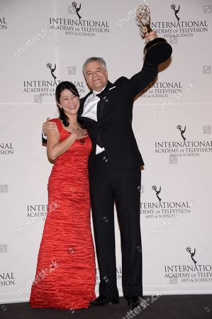 """Arts Programming"""" award winners Miho Yamamoto, left, and Damon Vignale pose in the International Emmy Awards gala press room at the New York Hilton, in New York"""