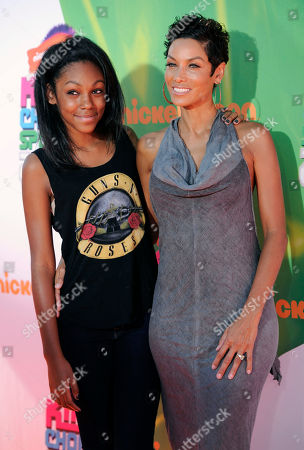Stock Photo of Nicole Murphy, right, and daughter Zola Murphy arrive at the Kids' Choice Sports Awards at UCLA's Pauley Pavilion, in Los Angeles