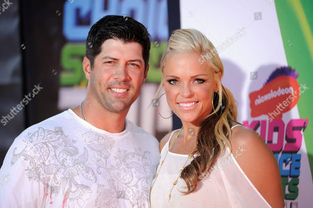 Stock Image of Casey Daigle, left, and Softball player Jennie Finch arrives at the Kids' Choice Sports Awards at UCLA's Pauley Pavilion, in Los Angeles