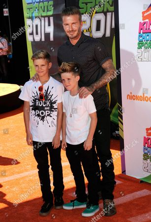 David Beckham, right, and his sons, from left, Romeo James Beckham and Cruz David Beckham arrive at the Kids' Choice Sports Awards at UCLA's Pauley Pavilion, in Los Angeles