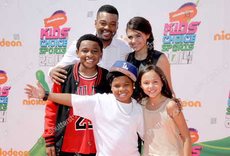 Chico Benymon, back left, and Amber Montana, and front left, Curtis Harris, Benjamin Flores Jr., and Breanna Yde arrive at the Kids' Choice Sports Awards at UCLA's Pauley Pavilion, in Los Angeles