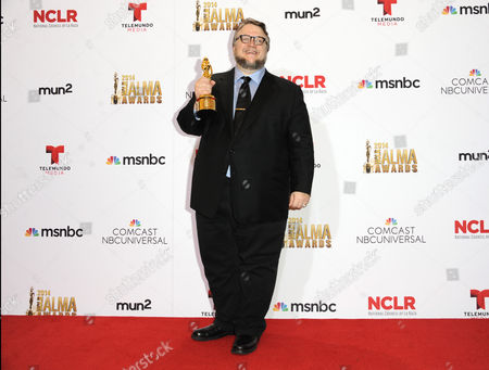 Guillermo Del Toro poses in the press room with the Anthony Quinn award for excellence at the NCLR ALMA Awards at the Pasadena Civic Auditorium, in Pasadena, Calif
