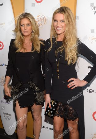 Models Rachel Hunter, left, and Veronica Varekova attend the 2014 Sports Illustrated Swimsuit 50th Anniversary Issue kick off event at Swimsuit Beach House on in New York