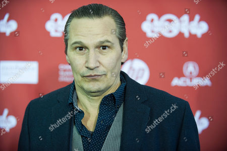 """Actor Nick Damici poses for a picture at the premiere for the film """"Cold in July"""" during the Sundance Film Festival, in Park City, Utah"""