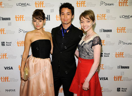 "Sophie Desmarais, from left, Shannon Kook and Julia Sarah Stone attend the premiere of ""Mommy"" on day 6 of the Toronto International Film Festival at the Princess of Wales Theatre, in Toronto"