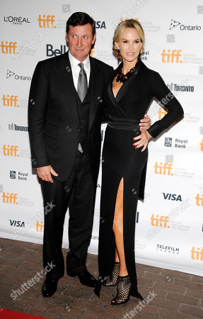 """Janet Jones Gretzky, a cast member in """"The Sound and the Fury,"""" poses with her husband, former hockey player Wayne Gretzky, at the premiere of the film at Ryerson Theatre during the Toronto International Film Festival, in Toronto"""