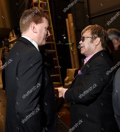 Gil Cates Jr., left, and Elton John attend Backstage at the Geffen, in Los Angeles