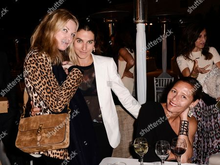 Stock Picture of From left to right, Brooke Wall, Kate Stirling, and Marlien Rentmeester attends the 2015 CISLA Annual Gala in Los Angeles on