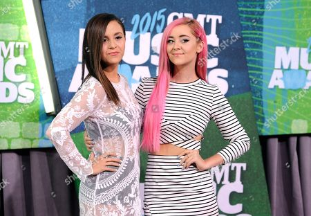 Megan Mace, left, and Liz Mace, of the musical group Megan and Liz, arrive at the CMT Music Awards at Bridgestone Arena, in Nashville, Tenn