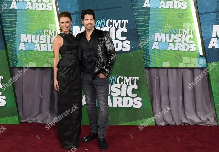 Kasey Hodges, left, and JT Hodges arrive at the CMT Music Awards at Bridgestone Arena, in Nashville, Tenn