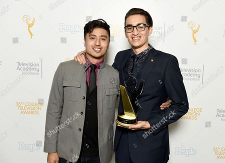 """Presenter Edward Bean, left, and Christopher Campbell of Art Center College of Design pose for a portrait with the first place award for Commercial """"Maglite - Dreamweaver"""" at the 36th College Television Awards, presented by the Television Academy Foundation at the Skirball Cultural Center in Los Angeles on"""