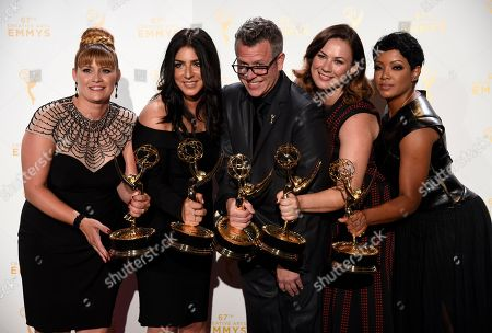 """Stock Picture of Daina Daigle, from left, Michelle Ceglia, Monte C. Haught, Amy Wood, Sherri B. Hamilton, winners of the award Outstanding Hairstyling For A Limited Series Or A Movie for American Horror Story: Freak Show"""" pose in the press room at the Creative Arts Emmy Awards at the Microsoft Theater, in Los Angeles"""