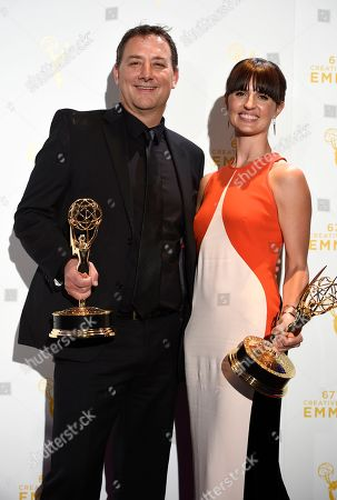 """Mathew Waters, left, and Onnalee Blank, winners of sound mixing for Outstanding Sound Mixing For A Comedy Or Drama Series (One Hour) for """"Game of Thrones,"""" pose in the press room at the Creative Arts Emmy Awards at the Microsoft Theater, in Los Angeles"""