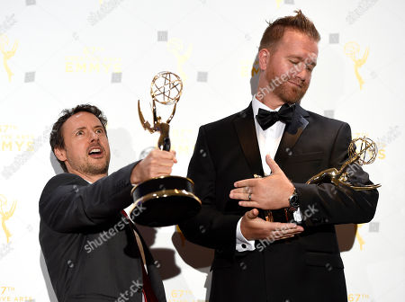Stock Image of Kyle Dunnigan, left, and Jim Roach, winners of the award for original music and lyrics for Inside Amy Schumer - Cool With It/Song Title: Girl You Don't Need Make Up pose in the press room at the Creative Arts Emmy Awards at the Microsoft Theater, in Los Angeles