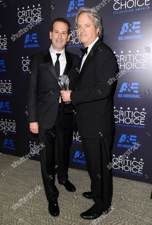 Darryl Frank, left, and Graham Yost pose in the press room with the award for best drama series for The Americans at the Critics' Choice Television Awards at the Beverly Hilton hotel, in Beverly Hills, Calif
