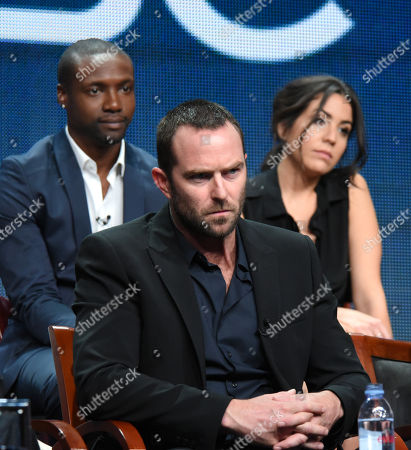 Rob Brown, from left, Sullivan Stapleton and Audrey Esparza participate in the 'Blindspot' panel at the The NBCUniversal Television Critics Association Summer Tour at the Beverly Hilton Hotel, in Beverly Hills, Calif