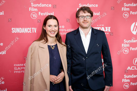 """Actress Caren Pistorius, left, and writer and director John MacLean, right, pose at the premiere of """"Slow West"""" during the 2015 Sundance Film Festival, in Park City, Utah"""