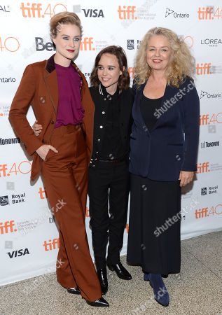 "Evan Rachel Wood, from left, Elliot Page and director Patricia Rozema attend a premiere for ""Into the Forest"" on day 3 of the Toronto International Film Festival at the Elgin Theatre, in Toronto"