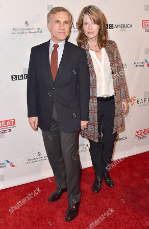 Christoph Waltz, left, and Judith Holste arrive at the BAFTA Awards Season Tea Party at the Four Seasons Hotel, in Los Angeles